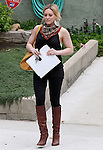 4-10-09.Hilary Duff carrying a yellow purse while she walks into a studio to help her accent in a new movie she is doing in Los Angeles ...AbilityFilms@yahoo.com.805-427-3519.www.AbilityFilms.com