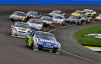 Nov. 9, 2008; Avondale, AZ, USA; NASCAR Sprint Cup Series driver Jimmie Johnson leads the field during the Checker Auto Parts 500 at Phoenix International Raceway. Mandatory Credit: Mark J. Rebilas-