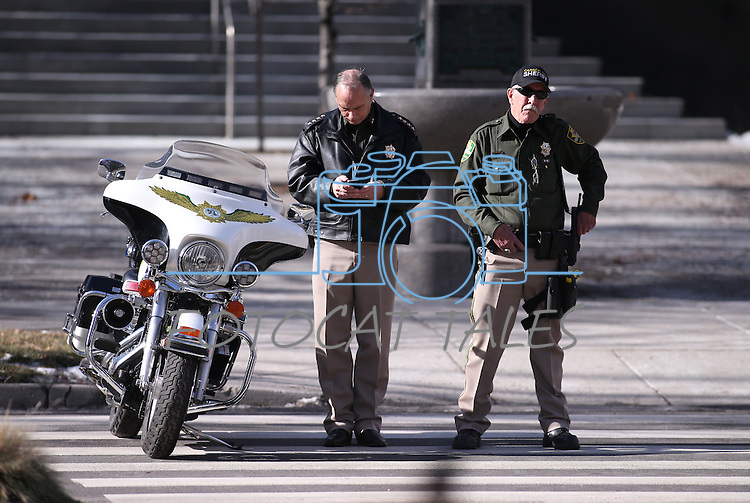 Carson City Sheriff Kenny Furlong and Reserve Commander Tom Crawford work the inauguration at the Capitol, in Carson City, Nev., on Monday, Jan. 5, 2015.<br /> Photo by Cathleen Allison