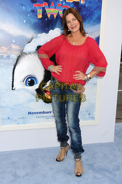 Marcia Gay Harden & guests.The World Premiere of 'Happy Feet Two' held at The Grauman's Chinese Theatre in Hollywood, California, USA..November 13th, 2011.full length pink top hands on hips jeans denim peep toe beige shoes ankle boots .CAP/ADM/BP.©Byron Purvis/AdMedia/Capital Pictures.
