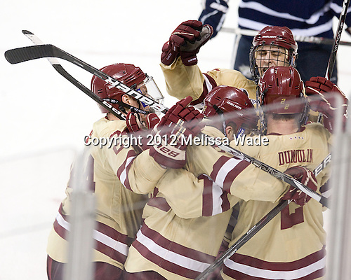 Bill Arnold (BC - 24), Chris Kreider (BC - 19), Brian Dumoulin (BC - 2) - The Boston College Eagles defeated the visiting University of New Hampshire Wildcats 4-3 on Friday, January 27, 2012, in the first game of a back-to-back home and home at Kelley Rink/Conte Forum in Chestnut Hill, Massachusetts.