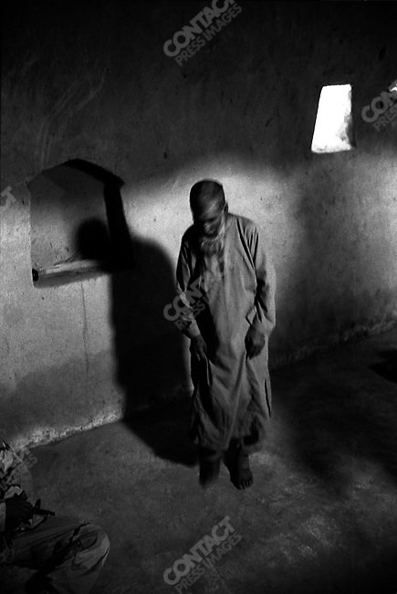 508th Infantry Regiment of the 173rd Airborne Brigade comes across a Mullah inside a Mosque in the village of Gonbaz, Shawali-Kot, Kandahar Province on a Taliban search. October 2005.