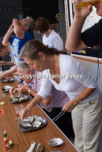 Whitstable Oyster Festival, Kent England 2007.  Oyster eating competition. 6 oysters in 10 seconds washed down with a 1/4 pint of Whitstable brewed ale.