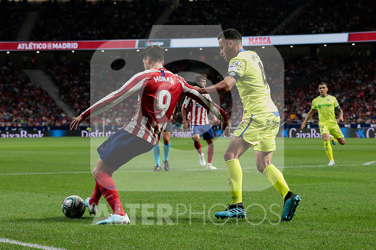 Atletico de Madrid's Alvaro Morata and Getafe CF's Bruno Gonzalez during La Liga match between Atletico de Madrid and Getafe CF at Wanda Metropolitano Stadium in Madrid, Spain. August 18, 2019. (ALTERPHOTOS/A. Perez Meca)