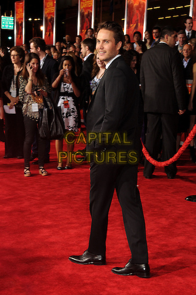 """Taylor Kitsch.""""John Carter"""" Los Angeles Premiere held at Regal Cinemas L.A. Live, Los Angeles, California, USA..February 22nd, 2012.full length black suit hand in pocket looking over shoulder .CAP/ADM/BP.©Byron Purvis/AdMedia/Capital Pictures."""