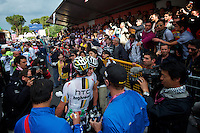 HTC soigneurs wait with recovery drinks while Cav. gives Mark Renshaw a well deserved hug--much to the delight of fans.