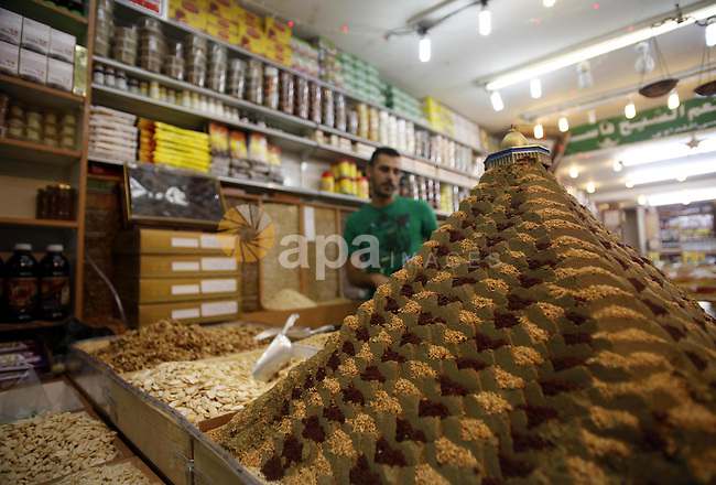 A Palestinian man sells spices in Jerusalem's old city during the Muslim fasting month of Ramadan on July 9, 2013. During Ramadan, one of the five main religious obligations under Islam, Muslims are required to abstain from food and from drinking liquids, smoking and having sex from dawn until dusk. Photo by Saeed Qaq