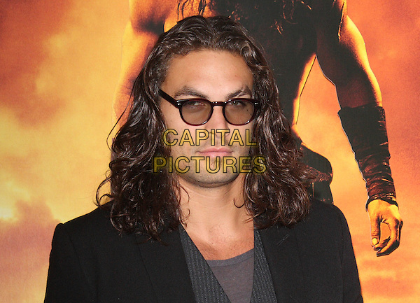 Jason Momoa at the European Premiere of 'Conan the Barbarian 3D' at the O2 Arena, London, England..August 14th 2011.headshot portrait black tinted glasses sunglasses shades pinstripe grey gray stubble facial hair .CAP/ROS.©Steve Ross/Capital Pictures