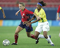 26 August 2004: Lindsay Tarpley dribbles the ball away from Brazil defender Elaine at Karaiskakis Stadium in Athens, Greece.   USA defeated Brazil 2-1 in overtime.   Credit: Michael Pimentel / ISI.