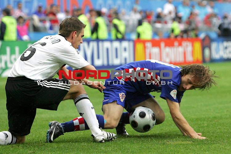 UEFA Euro 2008 Group B Match 11 Klagenfurt - W&ouml;rthersee-Stadion. Kroatien ( CRO ) - Deutschland ( GER ). Philipp Lahm ( Germany / Verteidiger / Defender / Bayern Muenchen #16 ) (l) im Kampf um den Ball mit Luka Modric ( Croatia / Mittelfeldspieler / Midfielder / Tottenham Hotspur #14 ) (r).<br /> Foto &copy; nph (  nordphoto  )