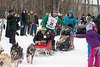 Tom Frode Johansen and team run past spectators on the bike/ski trail near University Lake with an Iditarider in the basket and a handler during the Anchorage, Alaska ceremonial start on Saturday, March 7 during the 2020 Iditarod race. Photo © 2020 by Ed Bennett/Bennett Images LLC