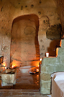 View through the en-suite bathroom with a free standing bath in one of the bedrooms at the unique Albergo Diffuso Le Grotte della Civita in Southern Italy housed in restored caves