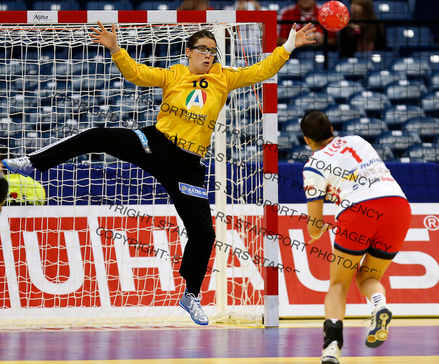 BELGRADE, SERBIA - DECEMBER 13: Goalkeeper Cleopatre Darleux (L) blocked shoot of Andrea Lekic (R) of Serbia during the Women's European Handball Championship 2012 Group I main round match between Serbia and France at Arena Hall on December 10, 2012 in Belgrade, Serbia. (Photo by Srdjan Stevanovic/Starsportphoto.com)