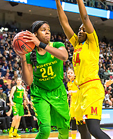 """3/25/17, Bridgeport, CT. - Ruthy Hebard passes under the hoop as Oregon downs Maryland in the """"sweet sixteen"""" as the Ducks upset the Terps 77-63 and advance in Mondays """"elite eight""""."""