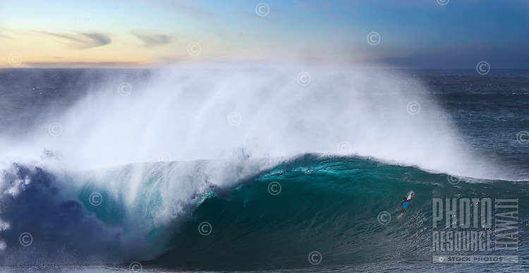 A surfer paddling farther out at Banzai Pipeline off of 'Ehukai Beach, North Shore of O'ahu.