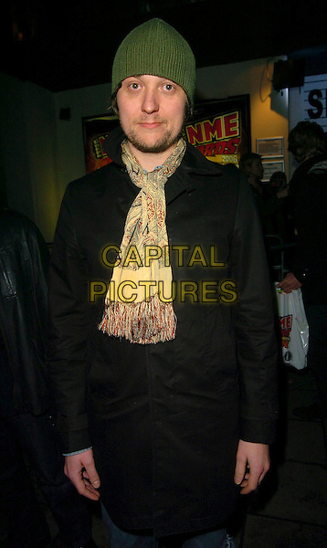ANDREW WHITE.OF KAISER CHIEFS.At the NME Awards After Show Party, .Hammersmith Palais, London, England, .February 23rd 2006..half length the green hat scarf.Ref: CAN.www.capitalpictures.com.sales@capitalpictures.com.©Can Nguyen/Capital Pictures