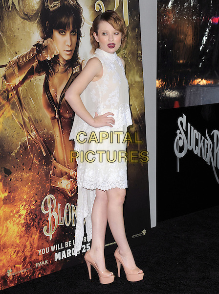 "EMILY BROWNING .at The Warner Bros. Pictures World Premiere of ""Sucker Punch"" held at The Grauman's Chinese Theatre in Hollywood, California, USA,.March 23rd 2011..full length dress hands on hips white sleeveless  beige lace high collar neck  platform nude patent heels shoes tiered side  .CAP/RKE/DVS.©DVS/RockinExposures/Capital Pictures."