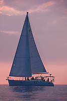 Yacht sailing on the west side of Oahu at sunset