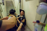 CHINA, Hong Kong: 10 August 2019 <br /> A pro-democracy protester gets treated for teargas after riot police fired teargas into a crowd of demonstrators in Tsim Sha Tsui district of Hong Kong. Demonstrators have taken to the streets of Hong Kong in protest of a controversial extradition bill since 9th of June which has resulted in several violent clashes.<br /> Rick Findler / Story Picture Agency