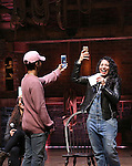 Jordan Fisher and Stephanie Klemons from 'Hamilton' greet High School students from The Rockefeller Foundation, and The Gilder Lehrman Institute of American History before a 'Hamilton' matinee performance at the Richard Rodgers Theatre on 11/30/2016 in New York City.