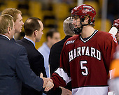 Jack Christian (Harvard 5) shakes hands with the BC coaching staff - Jim Logue (BC Assistant Coach), Greg Brown (BC Assistant Coach), (Cavanaugh, York). The Boston College Eagles defeated the Harvard University Crimson 6-5 in overtime on Monday, February 11, 2008, to win the 2008 Beanpot at the TD Banknorth Garden in Boston, Massachusetts.