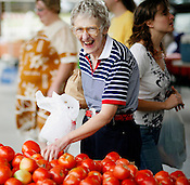 Karen Thompson, of Durham, is a tomato fanatic and finds the Durham Farmer's Market quite suitable to satisfy her needs.