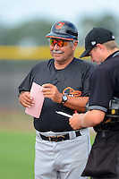 GCL Orioles manager Orlando Gomez (23) during a game against the GCL Rays on July 20, 2013 at Charlotte Sports Complex in Port Charlotte, Florida.  GCL Orioles defeated the GCL Rays 4-1.  (Mike Janes/Four Seam Images)