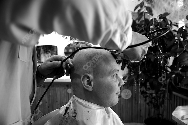 A prisoner has his hair cut at the prison hairdresser's. Prison colony #7 outside of Novgorod in the Novgorod region south of St. Petersburg, Russia, December 15, 2008.