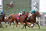 September 22, 2012. Philly Ace (#2, inside), ridden by Kendrick Carmouche, wins the Alphabet Soup Handicap Stakes by a nose over #8 Roadhog, Horacio Karamanos up, on the turf at Parx Racing, Bensalem, Pennsylvania.  Philly Ace is owned by his breeder, Brushwood Stable, and trained by Christophe Clement  (Joan Fairman Kanes/Eclipse Sportswire)