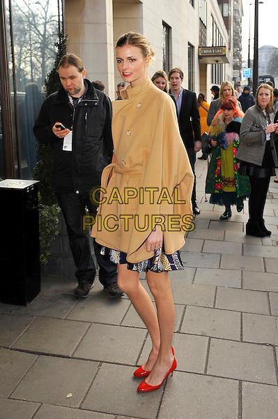 Jacquetta Wheeler.attending the Temperley London a/w 2013 catwalk show, Dorchester Hotel, London, England. .17th February 2013.London Fashion Week LFW full length beige coat jacket poncho side red shoes .CAP/MAR.© Martin Harris/Capital Pictures.