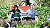 """United States President Barack Obama (R) and first lady Michelle Obama (L) imitate monsters as they read """"Where the wild things are""""during the White House Easter Egg Roll on the South Lawn of the White House March 28, 2016 in Washington, DC.<br /> Credit: Olivier Douliery / Pool via CNP"""