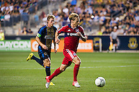 Chris Rolfe (18) of the Chicago Fire gets behind Brian Carroll (7) of the Philadelphia Union. The Chicago Fire defeated the Philadelphia Union 3-1 during a Major League Soccer (MLS) match at PPL Park in Chester, PA, on August 12, 2012.