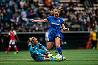 Seattle, WA - Thursday, May 26, 2016: Arsenal Ladies FC goalkeeper Emma Byrne (1)  defends Seattle Reign FC midfielder Lindsay Elston (6). The Seattle Reign FC of the National Women's Soccer League (NWSL) and Arsenal Ladies FC of the Women's Super League (FA WSL) played to a 1-1 tie during an international friendly at Memorial Stadium.