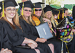 Happy graduates during the 2015 Western Nevada College Commencement held at the Pony Express Pavilion in Carson City, Nev., on Monday, May 18, 2015.<br /> Photo by Tim Dunn