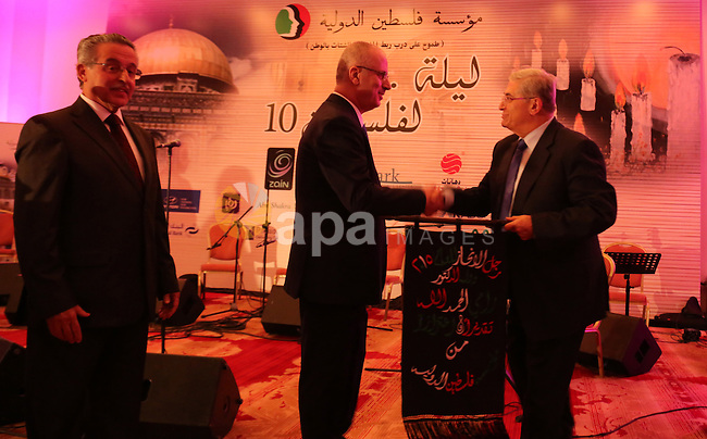 Palestinian Prime Minister Rami Hamdallah attends his honor ceremony in Amman on June 06, 2015. Photo by Prime Minister Office