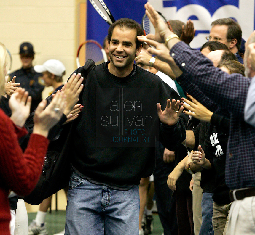 Pete Sampras arrives to the Convocation Center court through an impromtu human tunnel before The FedEx Shootout Atlanta at Kennesaw State University on Saturday, Dec. 9, 2006.