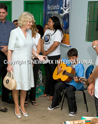 """CAMILLA, DUCHESS OF CORNWALL.Visits the Municipal Centre for Art and Education on a poor area of Manaus where the Duchess had a touching moment with one of the children of """"Curumim na Lata"""" (Children of the can-percussion) holding his hand..The Duchess also watched a fashion show, an experimental youth orchestra and a ballet. The centre seeks to use recycled goods in innovative ways..The clothes modeled by local girls in the fashion have been made from recycled material including bottle lids and crisp packets.The Duchess was wearing an Anna Valentine silk shift dress (Pale blue with white beaded detail).Fourth day Brazil on the second leg of their South American Tour, Manaus, Brazil_14/03/09......Mandatory Credit Photo: ©DIAS-NEWSPIX INTERNATIONAL..Please telephone : +441279324672 for usage fees..**ALL FEES PAYABLE TO: """"NEWSPIX INTERNATIONAL""""**..IMMEDIATE CONFIRMATION OF USAGE REQUIRED:.Newspix International, 31 Chinnery Hill, Bishop's Stortford, ENGLAND CM23 3PS.Tel:+441279 324672  ; Fax: +441279656877.Mobile:  07775681153.e-mail: info@newspixinternational.co.uk"""