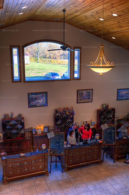 The second floor loft area provides a sweeping view of the sales and tasting bar below, in the tasting room at Gray Ghost Vineyards.  (HDR image)