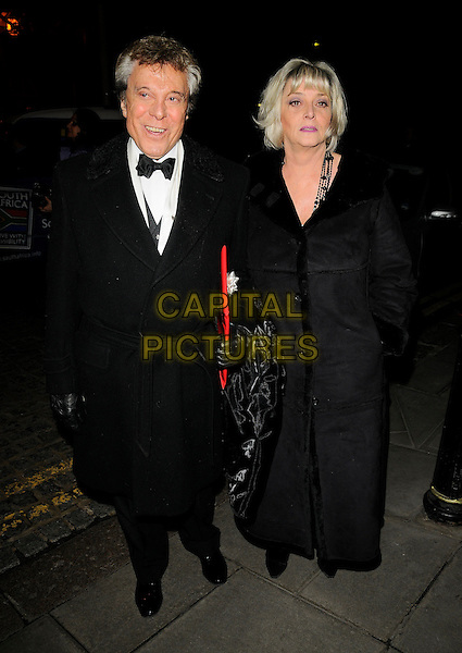 LIONEL BLAIR & GUEST.Christopher Biggins' 60th birthday party, Landmark hotel, Marylebone Road, London, England. .December 15th, 2008 .full length black coat jacket .CAP/CAN.©Can Nguyen/Capital Pictures.