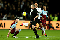29th January 2020; London Stadium, London, England; English Premier League Football, West Ham United versus Liverpool; Alex Oxlade-Chamberlain of Liverpool collides with the referee as he chases a loose ball