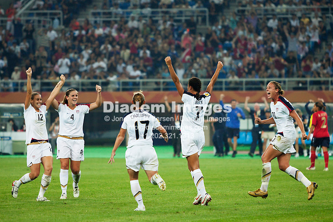 TIANJIN, CHINA - SEPTEMBER 22:  Shannon Boxx of the United States (7) celebrates with teammates after scoring a goal against England in the FIFA Women's World Cup quarterfinal match at Tianjin Olympic Sports Center Stadium on September 22, 2007 in Tianjin, China.  Editorial use only.  Commercial use prohibited.  No pushing to mobile device usage.  (Photograph by Jonathan Paul Larsen)