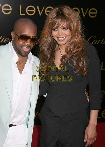 "JERMAINE DUPRI & JANET JACKSON.Cartier's 3rd Annual ""Love Day"" Celebration at a Private Residence in Bel Air, Los Angeles, California, USA..June 18th, 2008.half length black wrap top sunglasses shades beard facial hair mint green suit jacket white shirt couple .CAP/ADM/MJ.©Michael Jade/AdMedia/Capital Pictures."