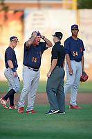 State College Spikes manager Joe Kruzel (13) argues a call with umpire Ben Rosen as Wood Myers (5) and Johan Oviedo (54) look on during a game against the Auburn Doubledays on August 21, 2017 at Falcon Park in Auburn, New York.  Kruzel was ejected from the game.  Auburn defeated State College 6-1.  (Mike Janes/Four Seam Images)