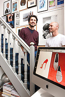 Stylists Stephane Verdino and Frederick Foubet- Marzorati on the staircase of their studio home