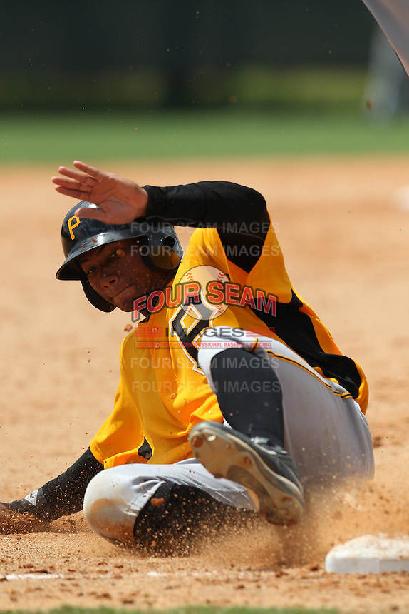 GCL Pirates third baseman Yhonathan Barrios #17 slides into third during a game against the GCL Braves at Disney Wide World of Sports on June 25, 2011 in Kissimmee, Florida.  The Pirates defeated the Braves 5-4 in ten innings.  (Mike Janes/Four Seam Images)