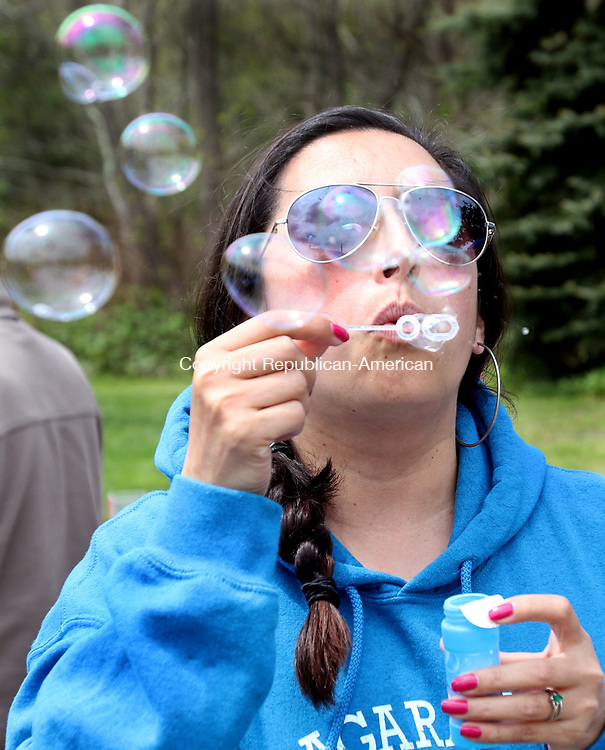 BEACON FALLS CT. 07 May 2017-050717SV08-Cristina Summa of Beacon Falls blows some bubbles for her nephew at the 19th annual Duck Race and Riverfest in Beacon Falls Sunday.<br /> Steven Valenti Republican-American