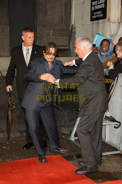 Johnny Depp.'The Rum Diary' European film premiere, Odeon Kensington cinema, London, England..3rd November 2011.full length blue suit waistcoat tinted glasses goatee moustache mustache facial hair hands arms holding hands funny gesture.CAP/PL.©Phil Loftus/Capital Pictures.