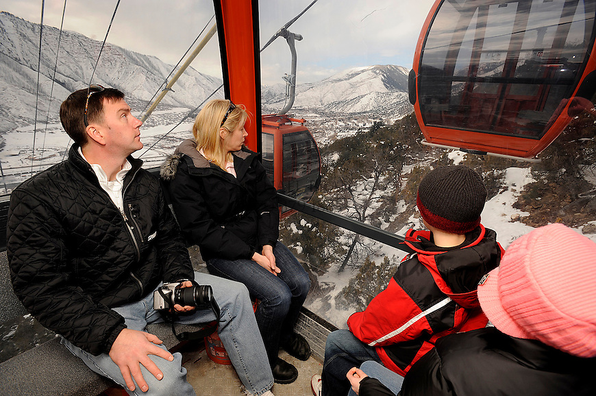 From the left, Chris Armitage, enjoys a ride on the Iron Mountain Tramway with his wife Christie, and children Jack, 7, and Amanda, 9. The tramway rises from Glenwood Springs, CO. Michael Brands for The New York Times.