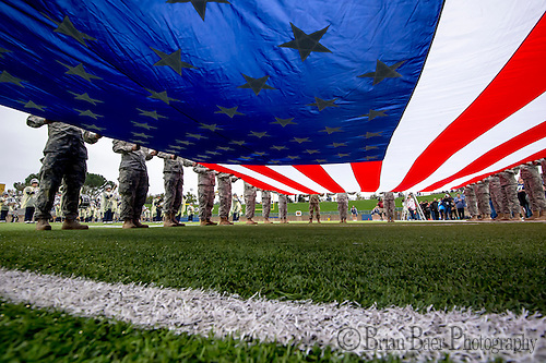 Servicemen hold up the American flag before the game as the UC Davis Aggies host the Sacramento State Hornets in the Causeway Classic,  Saturday Nov 19, 2016.<br /> photo by Brian Baer (Brian Baer/Special to The Bee)