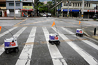 MEDELLÍN, COLOMBIA-APRIL 24: Robots are seen used to deliver food during the new pandemic Coronavirus, COVID-19. on April 24, 2020, in Medellín, Colombia. The launch of Colombian on-demand services Rappi is using robots on wheels designed by KiwiBot as a way to bring food to people who were forced to stay home during childbirth as a preventive measure to stop the spread of COVID-19 (Photo from Fredy Builes / VIEWpress via Getty Images).